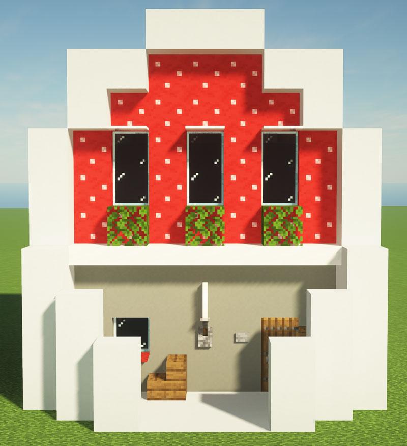 赤色のキノコブロックを使用したたまご型モダンハウス