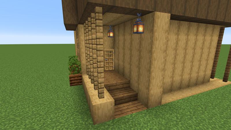 木の温もりがあるモダンな家の玄関ポーチの照明